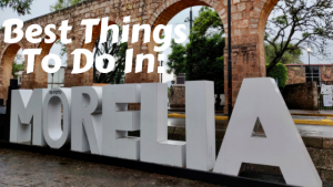 Things to do in Morelia title - Morelia sign in front of aqueduct