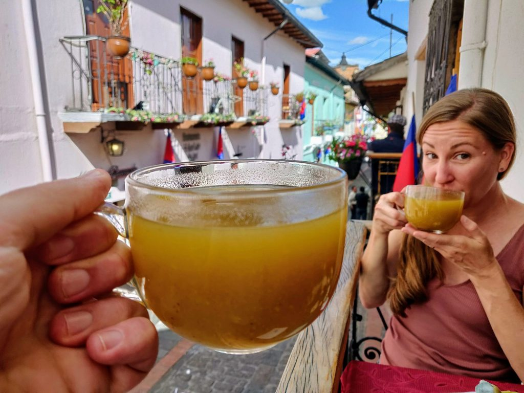 Drinking Canelazo on La Ronda in Quito Ecuador