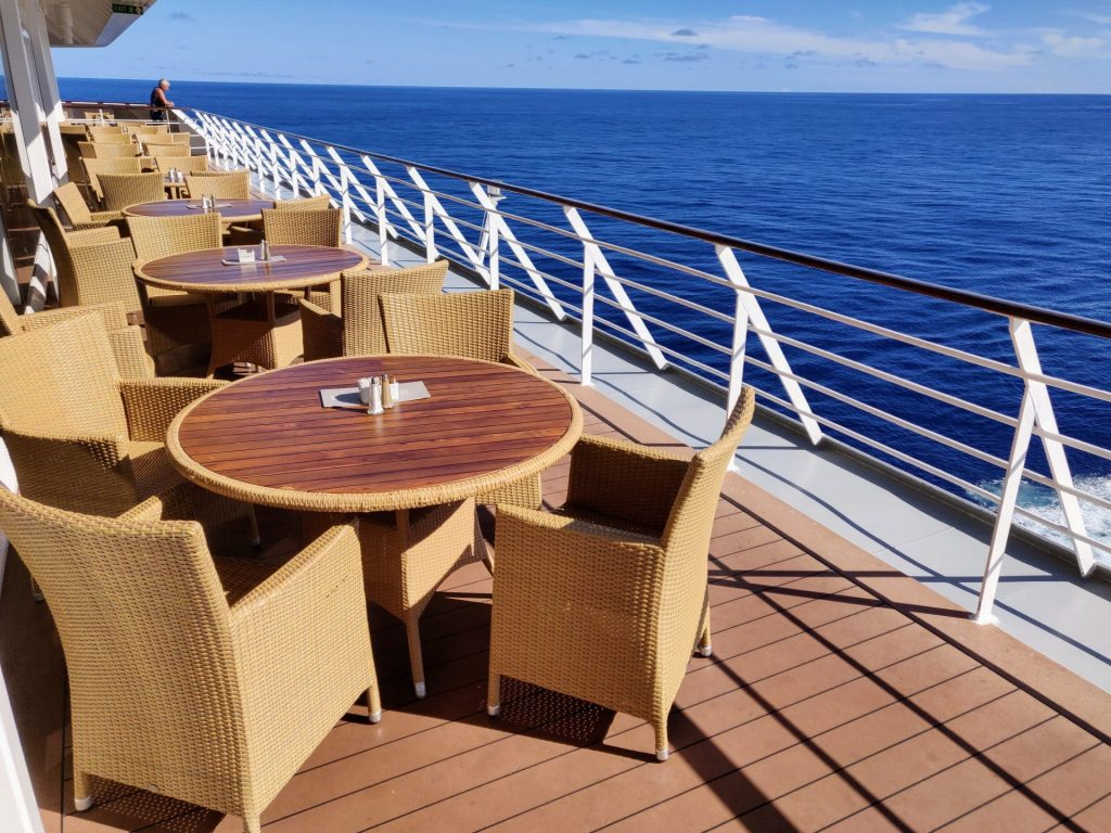 Empty tables on back of ship
