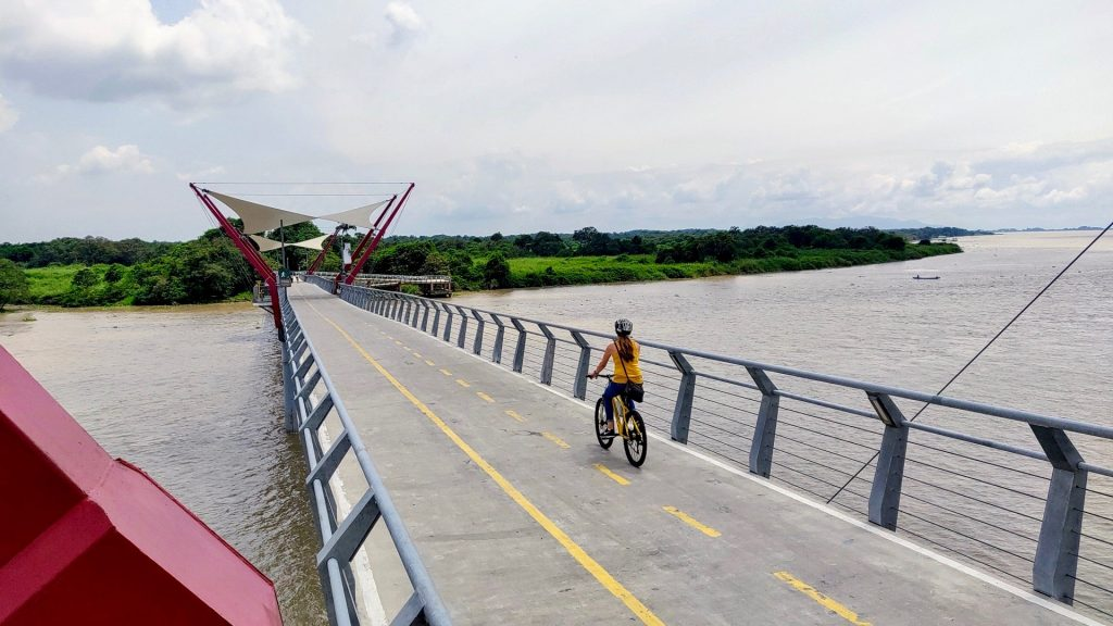 cycling across the Santay Island bridge