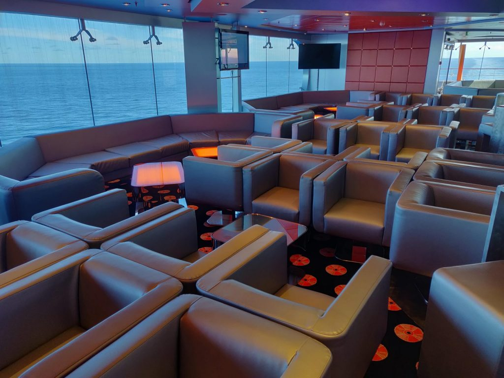 Empty chairs in club on cruise ship