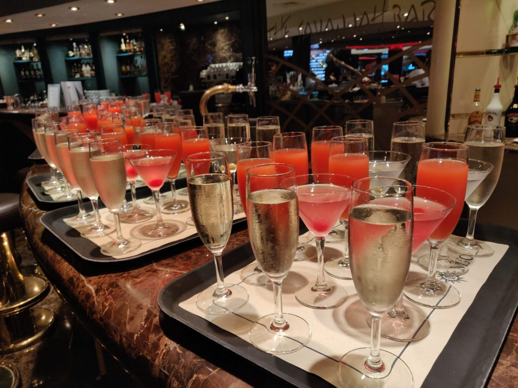 champagne and other free drinks on a cruise