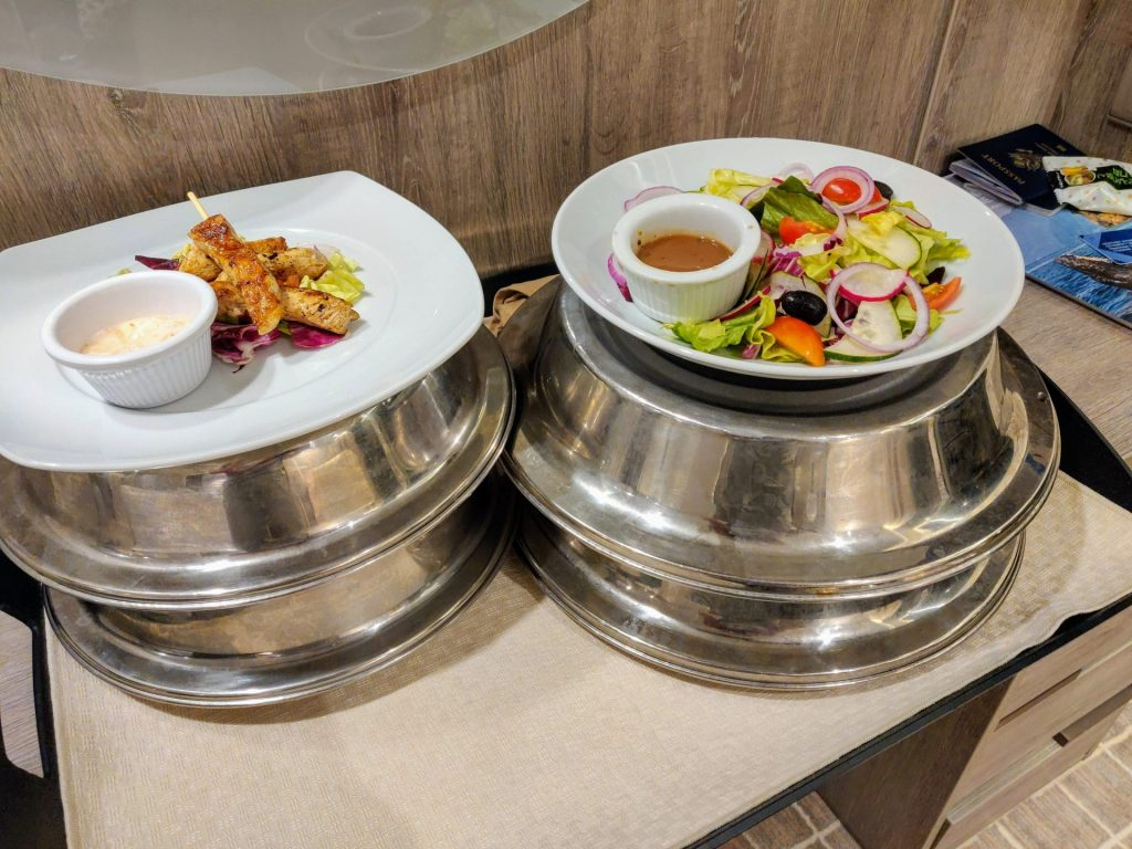 room service on cruise: chicken skewers and salad