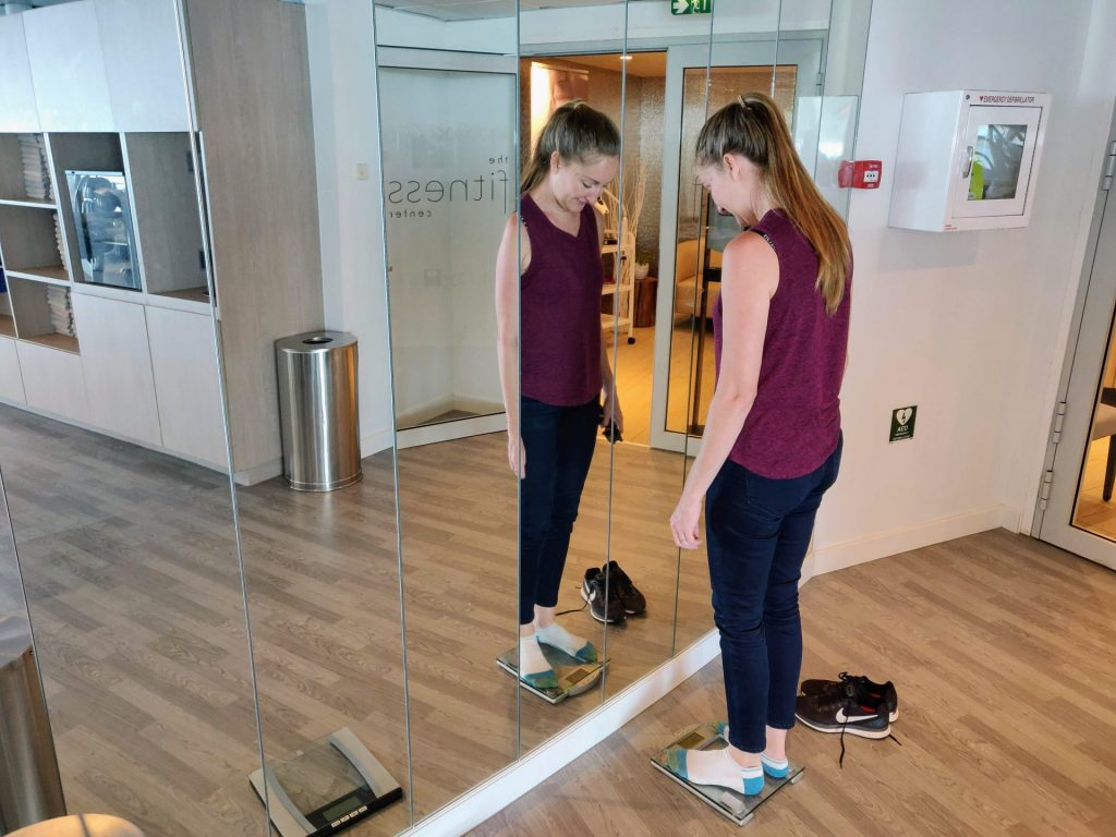 woman standing on scale in cruise ship gym