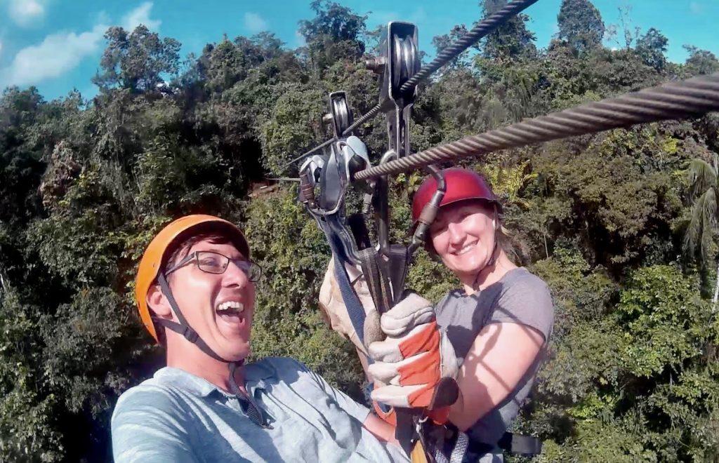 John & Heather, of Roaming Around the World, on tandem zipline in Mindo Cloud Forest