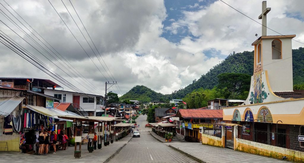 The main street in Mindo with shops, church, and tour agencies