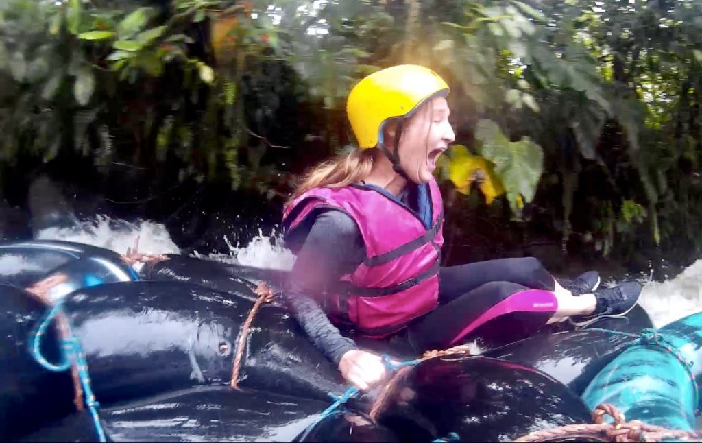 Heather looks terrified going down rapids while tubing through the Mindo Cloud Forest