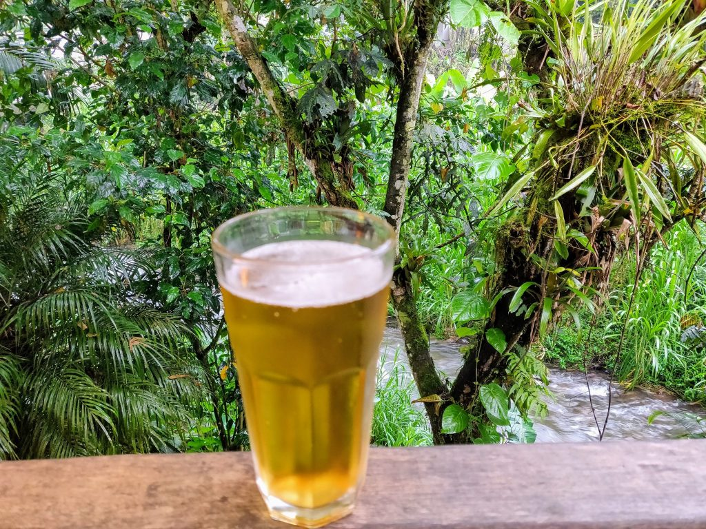 Pint of beer in Mindo on the river at Dragonfly Inn