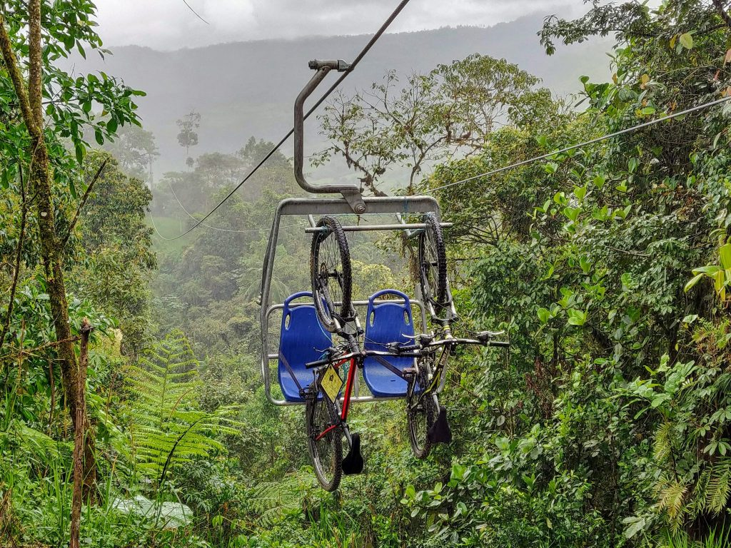mountain bikes on chairlift in Mindo Ecuador at the Minjoy Park chairlift