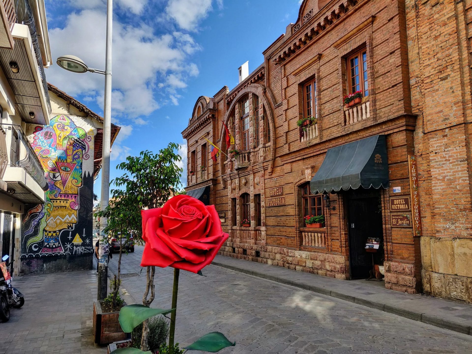 Cuenca city street with rose sculpture