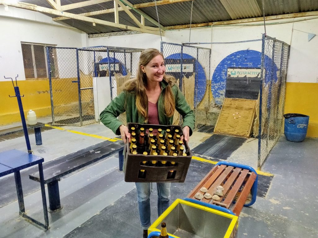 holding crate of beer at tejo court