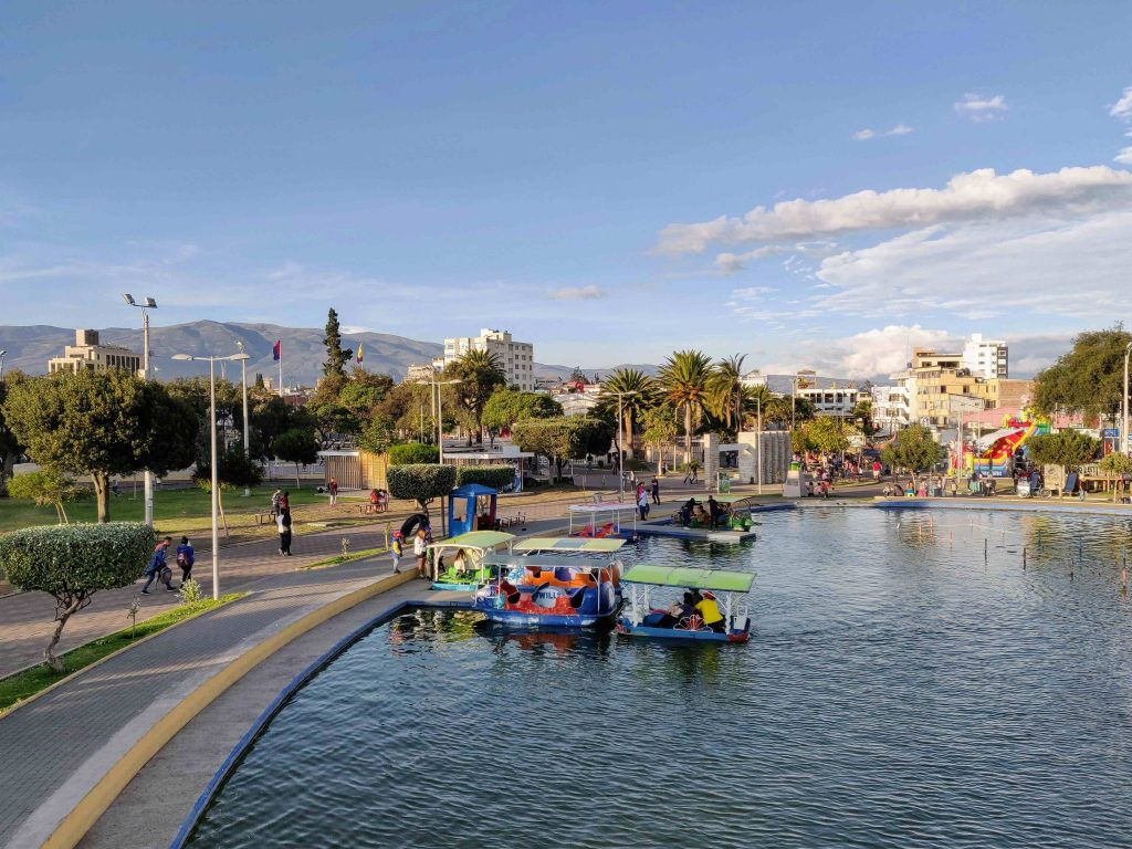 paddleboats on man-made lake in Parque Guayaquil Riobamba