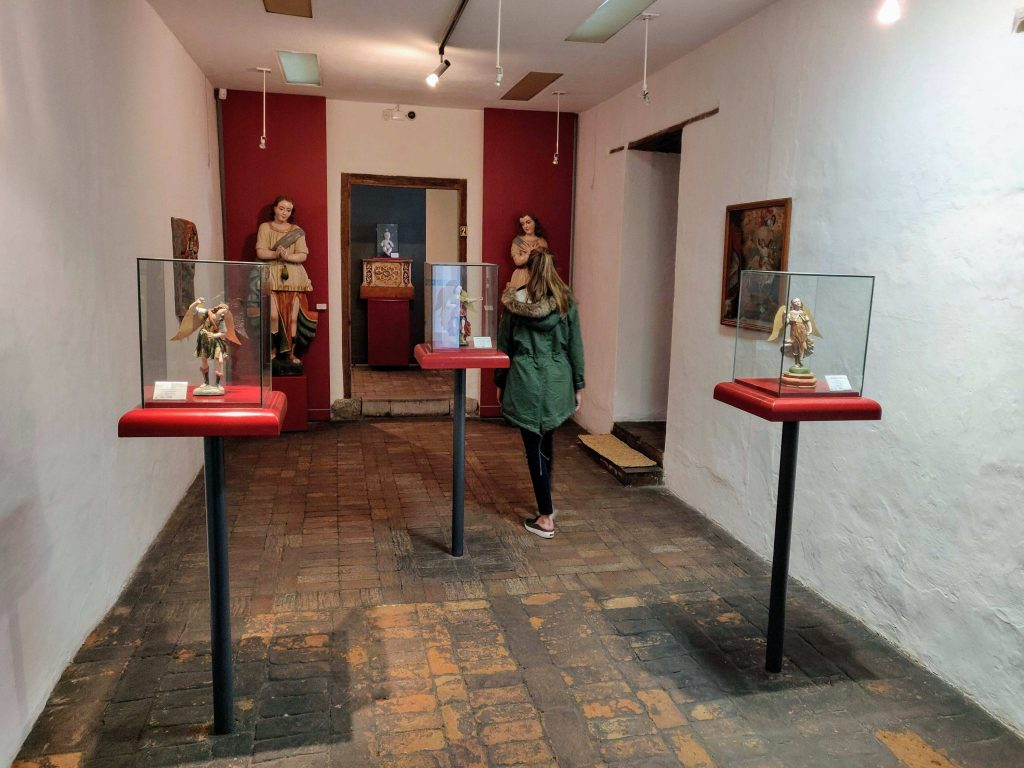 Heather looks at religious sculptures at Riobamba Religious Art Museum