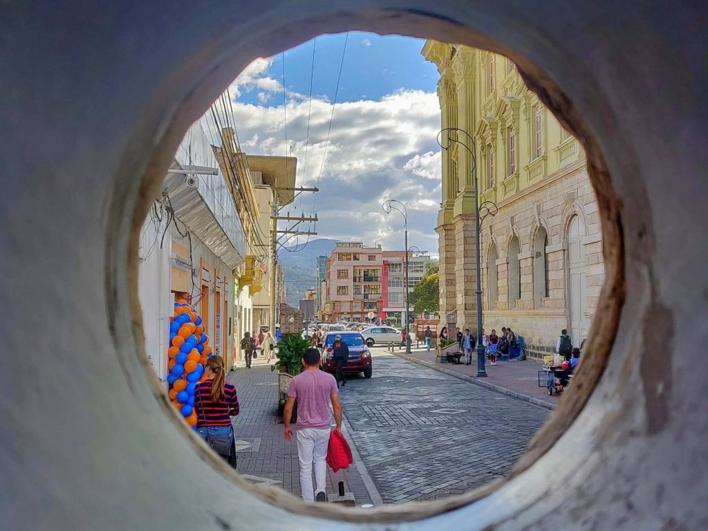 Looking onto Riobamba street from a narrow tunnel