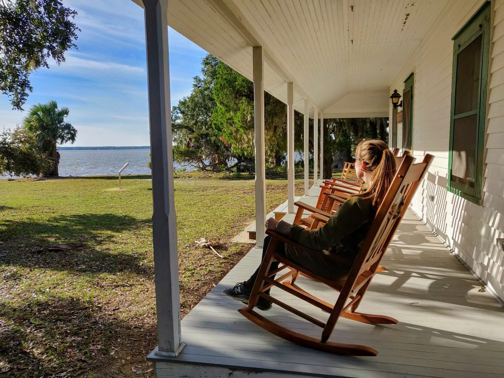 Heather sitting on rocking chair on porch in Cumberland Island