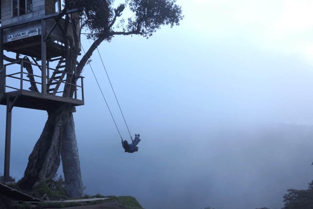 Casa del Arbol swing from a treehouse off a cliffside in Ecuador