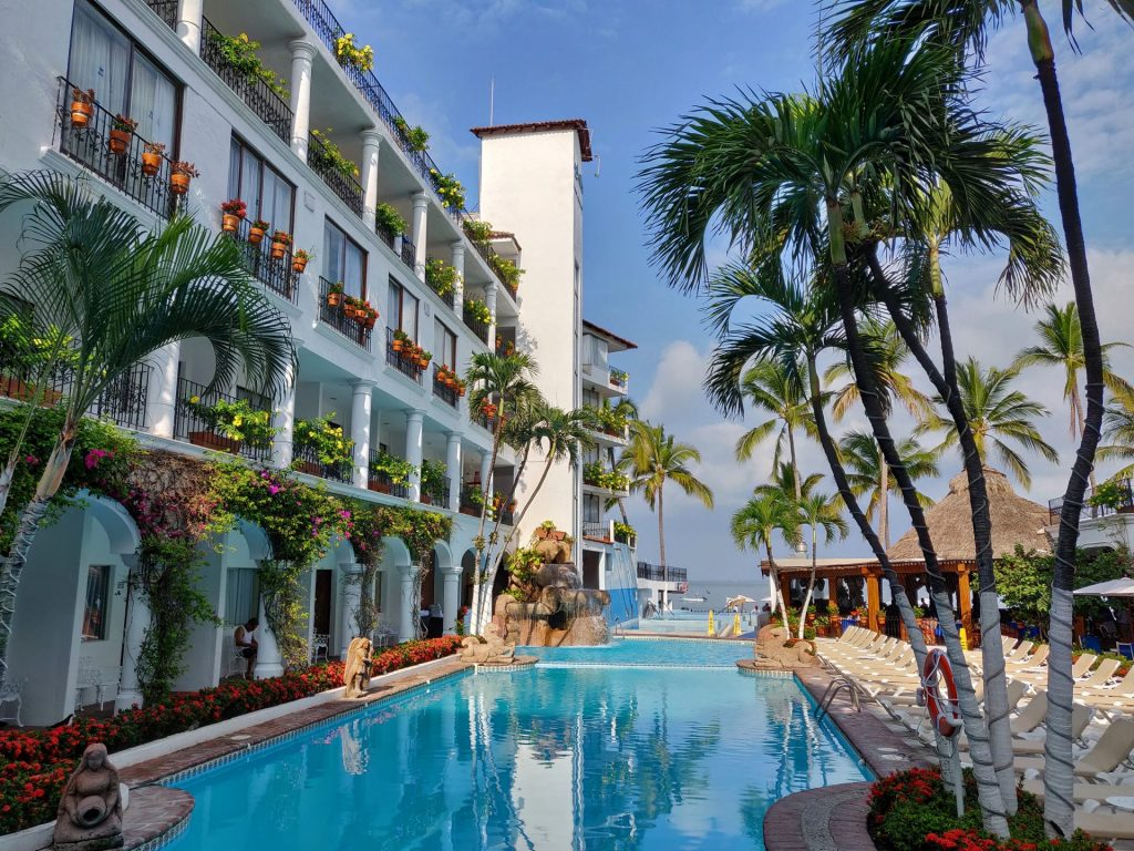 Pool and palm trees at Playa Los Arcos Resort