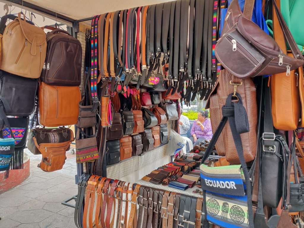leather belts, bags, backpacks, wallets, and other leather goods for sale at the leather goods at the Cotacachi Sunday market