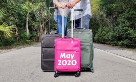 Three suitcases announcing we're expecting a baby in May 2020