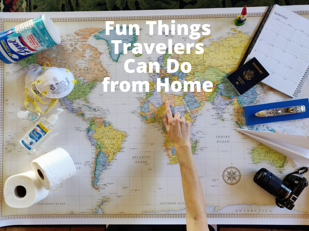 Title Image reading: Fun Things Travelers Can Do from Home, showing map of the world with items such as lysol wipes, face masks, hand sanitizer, toilet paper, paper airplane, model cruise ship, camera, planner, and passport
