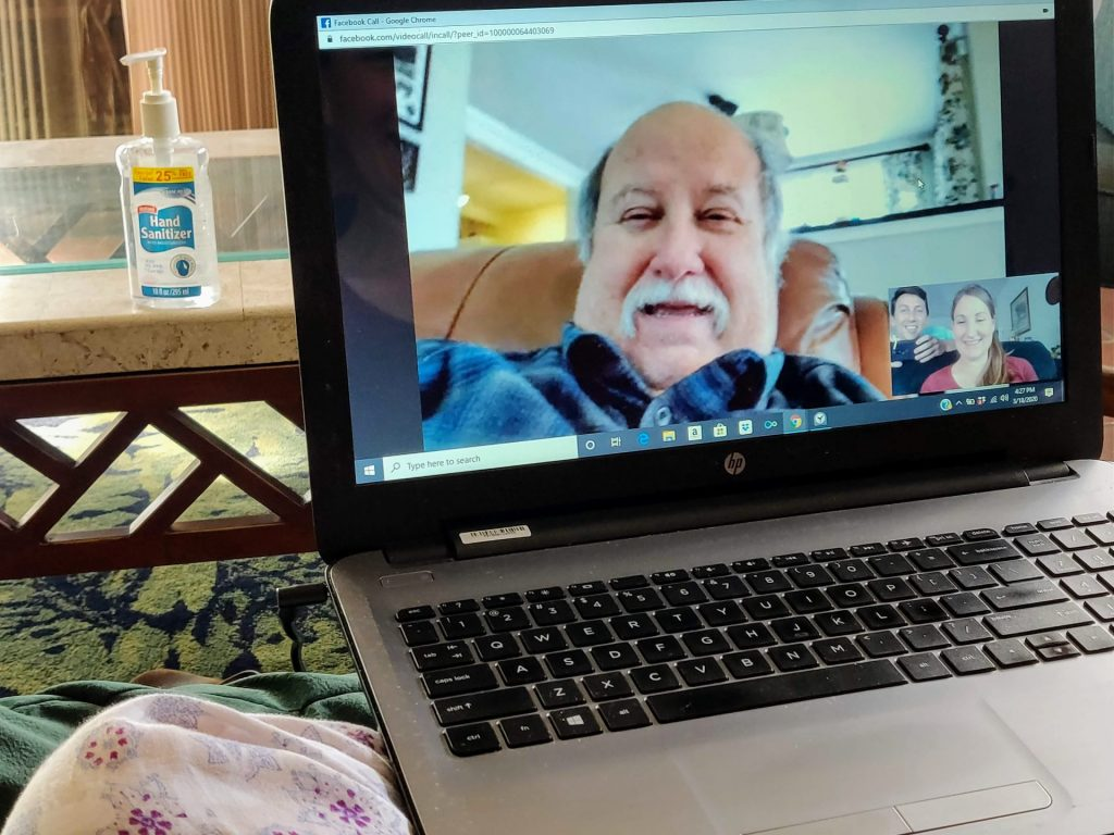 On a laptop video chatting with Heather's dad using Facebook Messenger