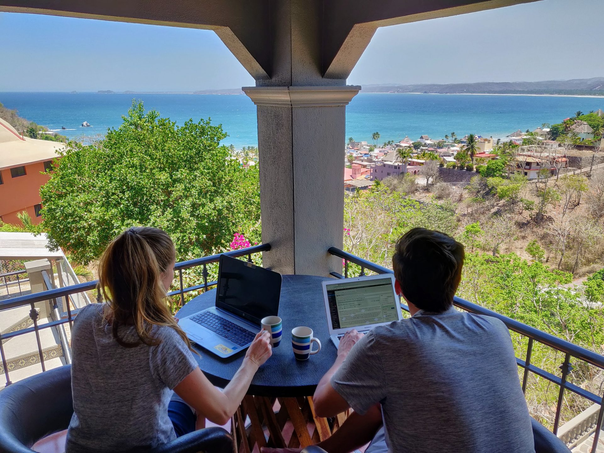 using laptops from apartment overlooking the ocean